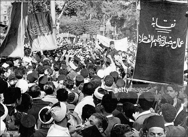 Picture dated 16 December 1947 shows president of the Young Men's Moslem Association Saleh Harb Pasha carried on shoulders of some of his followers...