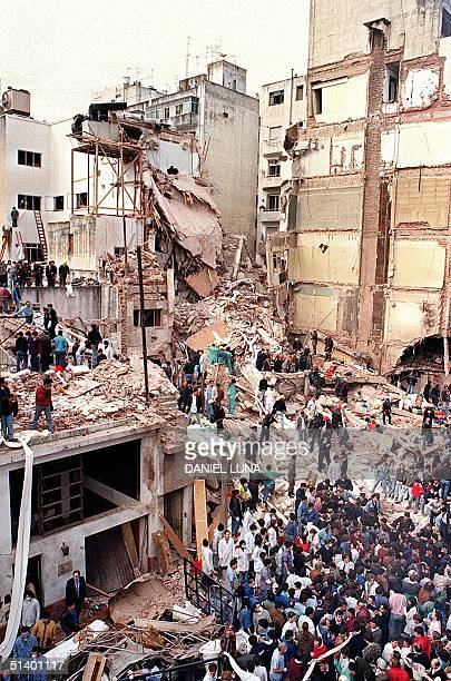Picture dated 18 July 1994 showing rescue teams saerching the site where a powerful explosion destroyed a seven storey building housing the Jewish...