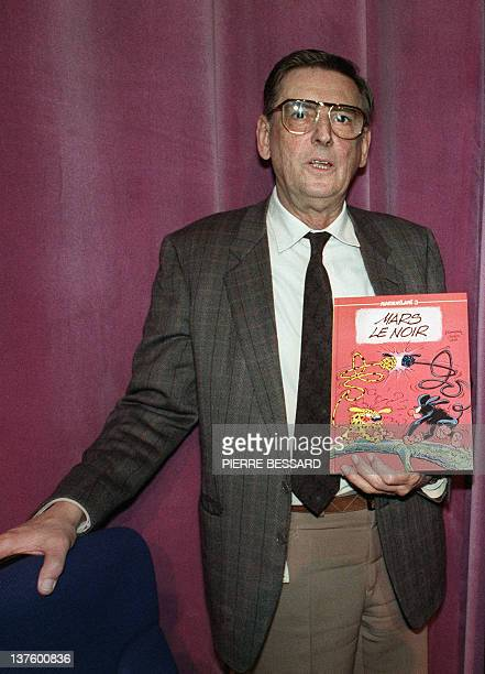 Picture dated 18 March 1989 of Belgian comics artist André Franquin holding a press conference at the first European Comics Show in Grenoble André...