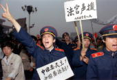 Picture dated 18 May 1989 shows Beijing magistrates wearing court uniforms joining workers demonstrating in Beijing streets in support of student...