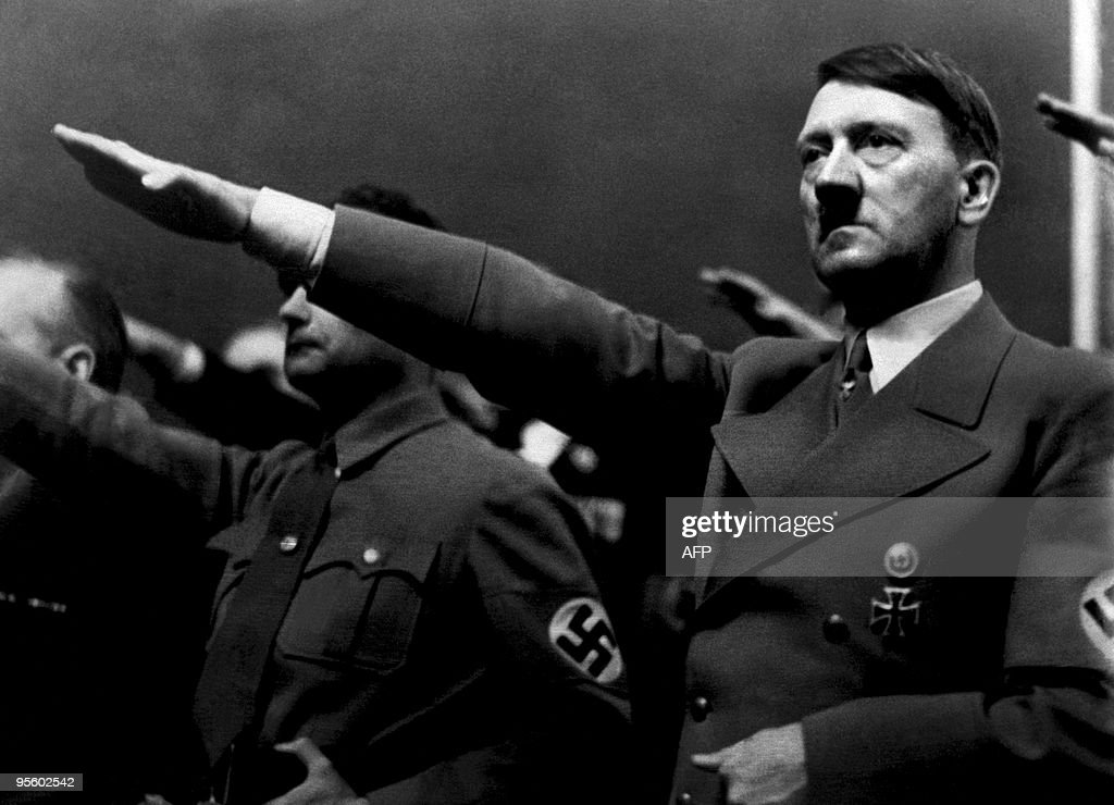 A picture dated 1939 shows German Nazi Chancellor Adolf Hitler giving the nazi salute during a rally next to 'Deputy Furhrer' Rudolf Hess AFP PHOTO /...