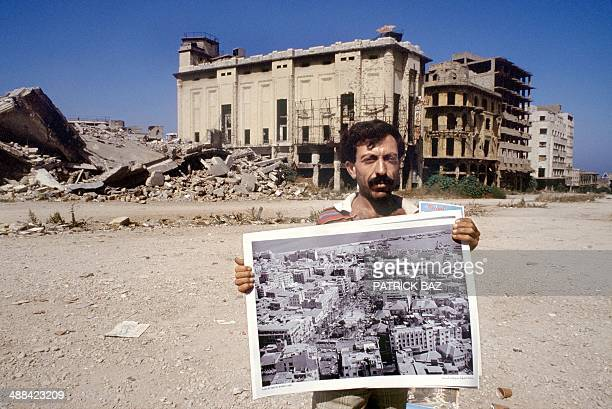 Picture dated 1990 shows a street vendor in downtown Beirut selling posters of the same place in the late 60s The Lebanese civil war broke out in...