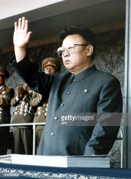 Picture dated 1O October 1995 shows North Korean leader Kim Jong Il waves during a military parade in Pyongyang On Kim's 57th birthday 16 February...