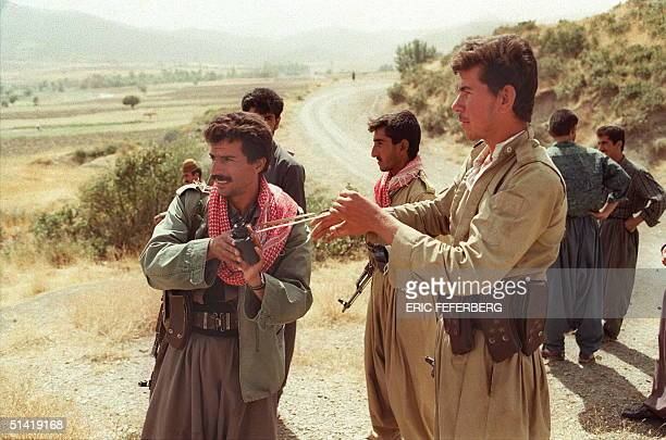 Picture dated 22 September 1996 of Pershmerga fighters of the Kurdistan Democratic Party keeping watch over the IranIraq border near Bachmar Two...