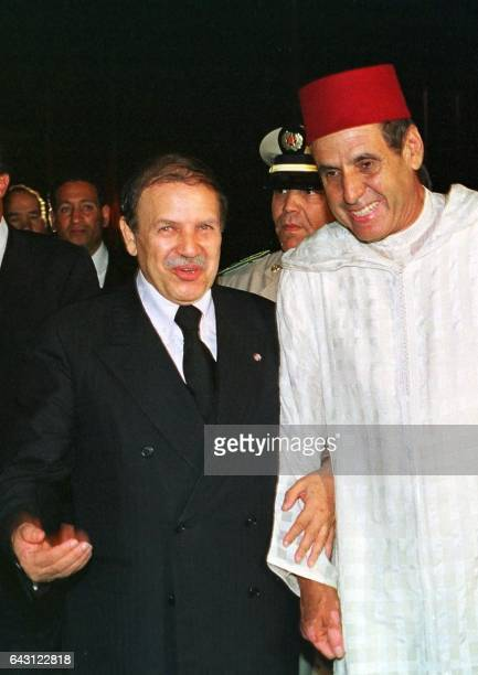 Picture dated 25 July 1999 showing Moroccan Minister of State for the Interior Driss Basri walking with Algerian President Abdelaziz Bouteflika at...