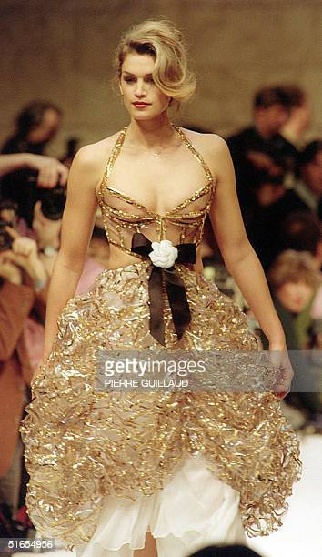 Picture dated 26 January 1993 shows top model Cindy Crawford as she wears a transparent plastic dress over ivory georgette styled by Karl Lagerfeld...