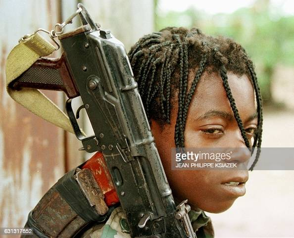 Picture dated 26 October 1997 shows a 15yearold Congolese Cobra militiaman nicknamed 'the Japanese' for his fast skills in combat waiting 26 October...