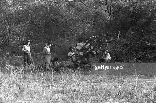 Picture dated April 1961 of Cuban troops using sovietmade antiaircraft artillery called in Cuba 'Cuatro bocas' during the Bay of Pigs Invasion The...