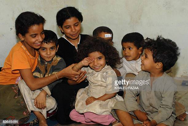 A picture dated July 8 2008 shows Yemeni child bride Nojud Ali at her family's house with her siblings in the suburbs of Sanaa Nojud who broke tribal...