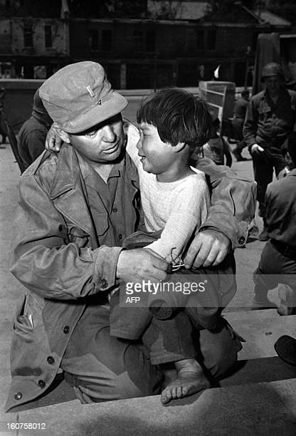 A picture dated May 23 1951 shows a Korean orphan little girl crying in the arms of US lieutenant William Doernbach during Korean War Doernabach had...