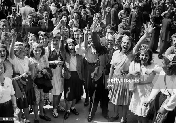 Picture dated of May 8 1945 showing young girls celebrating the unconditionnal German capitulation in the streets of Paris at the end of the second...