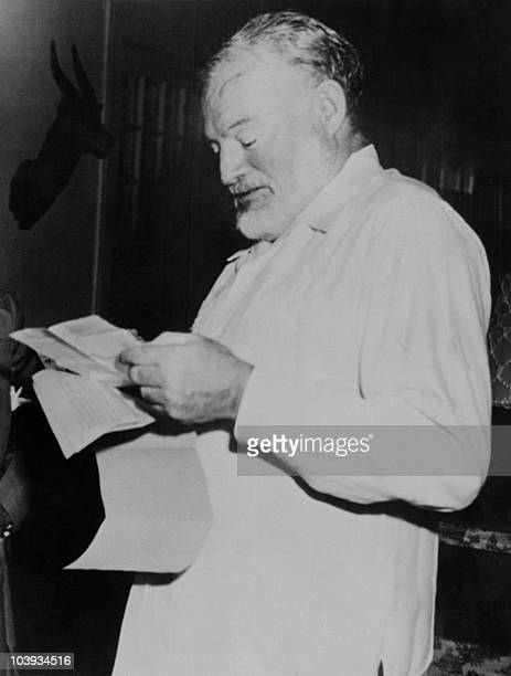 Picture dated of the 1952 showing American writer Ernest Hemingway learning he won the Pullitzer prize for his novel 'The Old men and the sea'