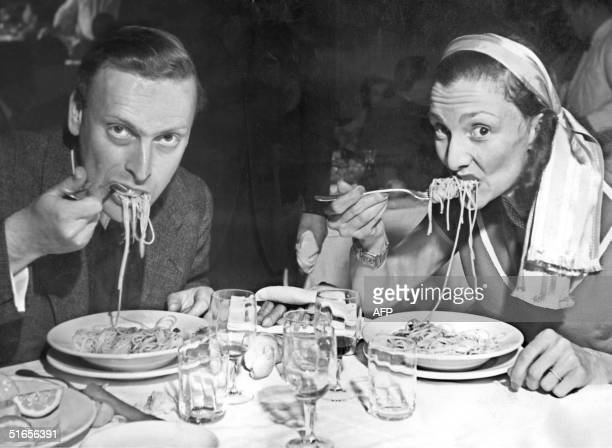 Picture dated of the 50's showing British violonist Yehudi Menuhin and his wife Diana eating spaghetti before a concert the Maestro gave at the...