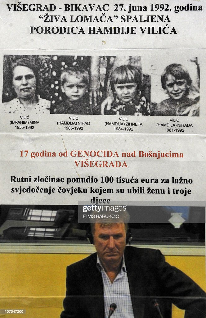 Picture dated on December 4, 2012 in Sarajevo shows a poster showing (on bottom) a pictured of Bosnian Muslim man and survivor of the 1992 massacres in Eastern-Bosnian town of Visegrad, Hamdija Vilic, during his deposition at the warcrimes in the Hague and (on top) pictures of his wife and three children killed in the massacre tribunal . Former Bosnian Serb army officers Sredoje Lukic and Milan Lukic are on trial at the International Criminal Tribunal for the former Yugoslavia's (ICTY) on charges of war crimes and crimes against humanity for their role in killing of more than 120 Bosnian Muslims in Visegrad in summer 1992. The UN's Yugoslav war crimes court today upheld Bosnian Serb paramilitary leader Milan Lukic's life sentence for murdering Muslims during Bosnia's bloody 1992-95 war and ordered his cousin and co-accused to remain in jail although with a lesser sentence.