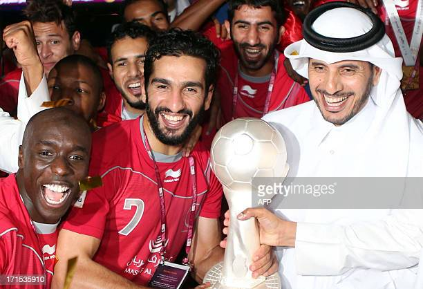 A picture dated on May 4 2013 shows Qatari Minister of State for Internal Affairs Abdullah bin Nasser bin Khalifa AlThani celebrating with Lekhwiya...