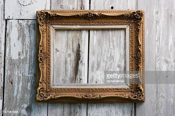 Picture frame on old building wall