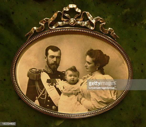 Picture Frame Silver enamel wood painted to imitate snakewood Silvergilt enamel Photo of Tsar Nicholas and his wife Alexandra with the Tsarevich...