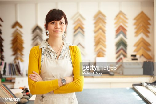 Picture framer in her shop : Stock Photo