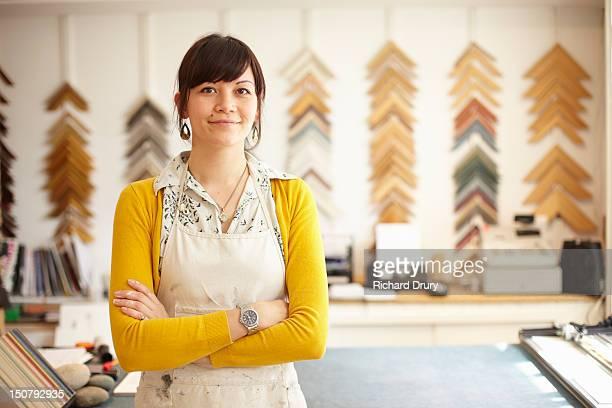 Picture framer in her shop