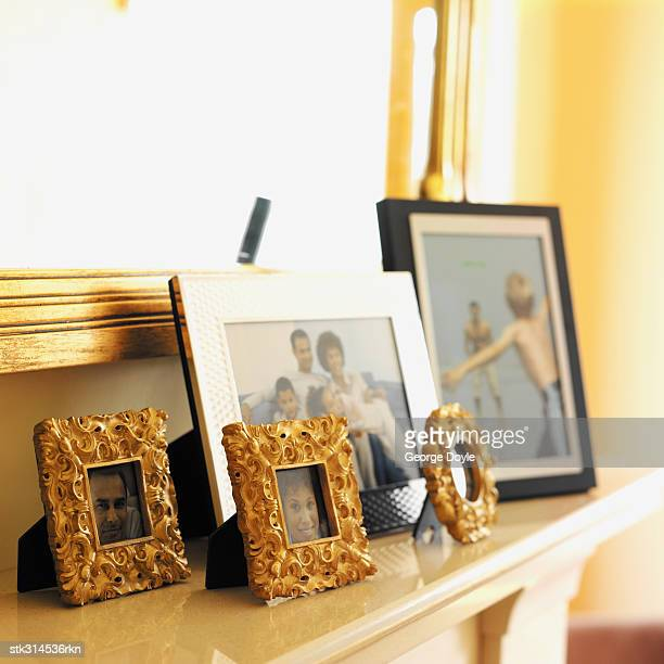 picture frames on a mantelpiece