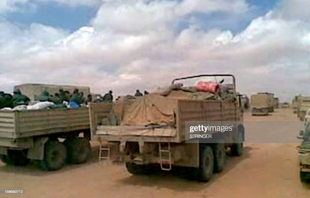 A picture grabbed on images obtained by AFP in Mali on January 18, 2013 and filmed with a mobile phone in 2012 shows a rebel convoy in the Malian desert . BM-21 Grad rocket launchers, the type of equipment that was once part of the Libyan army's arsenal, make up part of the convoy as do Mali army vehicles. The Malian army backed by French troops wrested a key central town from Islamist rebels, as the UN warned up to a million people could be driven from their homes by fighting in coming months. As a dramatic hostage siege unfolded in neighbouring Algeria -- where Islamists took hundreds captive in a gas field to retaliate for the week-old military intervention in Mali, sparking a deadly commando raid -- fighting has continued unabated on the ground in Mali. AFP PHOTO / STRINGER