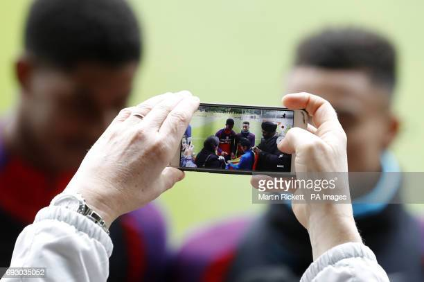 A picture is taken of England's Marcus Rashford and Jesse Lingard during the training session at St George's Park Burton