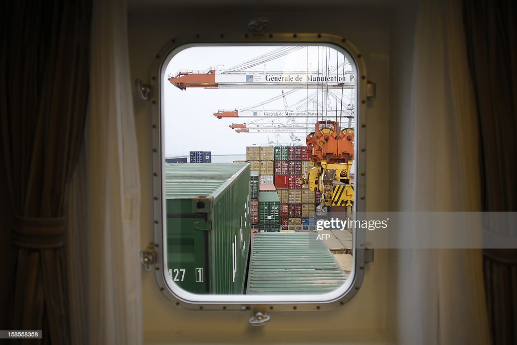 A picture is taken through a window of a bedroom of the Marco Polo, flying a British flag and said to be the world's biggest container ship by French owners CMA CGM, moored in the port of Le Havre, western France, early on December 19, 2012. The Marco Polo was given its champagne christening in the Belgian port of Zeebrugge on December 18, 2012. The ship, which is 396 metres (yards) long -- the length of four football fields -- was built in South Korea and was to head back to Asia after a stop in France. It is said to be the largest container in the world measured by capacity, as it can hold 16,020 TEU (twenty-foot equivalent unit containers) -- or 97 kilometres of containers lined up one by one.