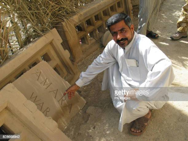 Picture issued April 17 2003 of Keeper Hassan Hatif Moson Ali who has tended the graves at the lost memorial at Al Amara even though he hasn't been...