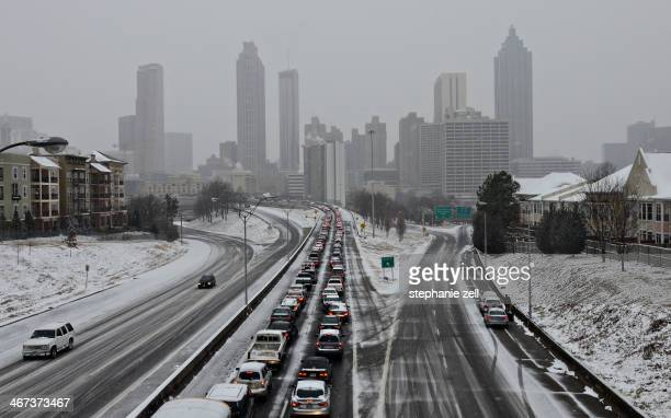 CONTENT] A picture looking towards downtown Atlanta showing the city during the throws of a snowstorm when traffic is at a standstill in one...