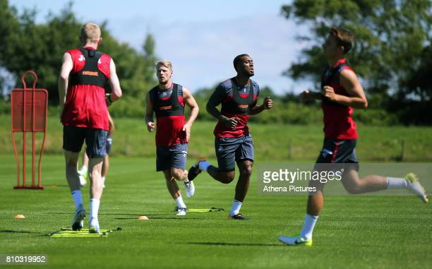 Oliver McBurnie Stephen Kingsley Leroy Fer and Thomas Carroll in action during the Swansea City Training at The Fairwood Training Ground on July 5...