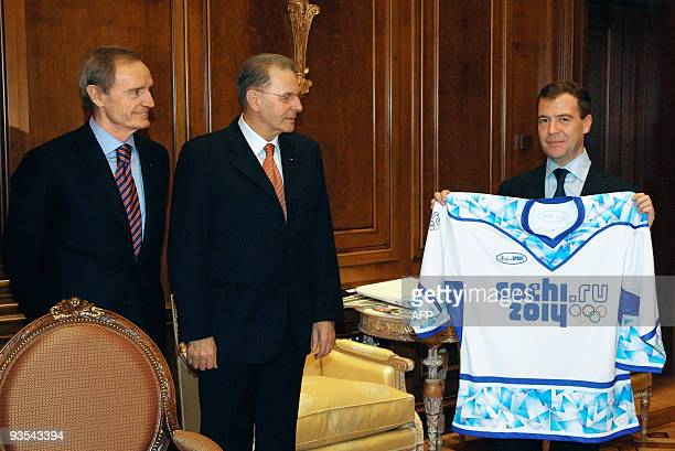 Picture made available on December 2 2009 shows Russian President Dmitry Medvedev holding a jersy with the new logo for the Sochi 2014 Winter Olympic...