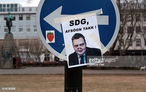 A picture mimicking Prime Minister Sigmundur David Gunnlaugsson is seen near the Icelandic Parliament building in downtown Reykjavik as the Prime...