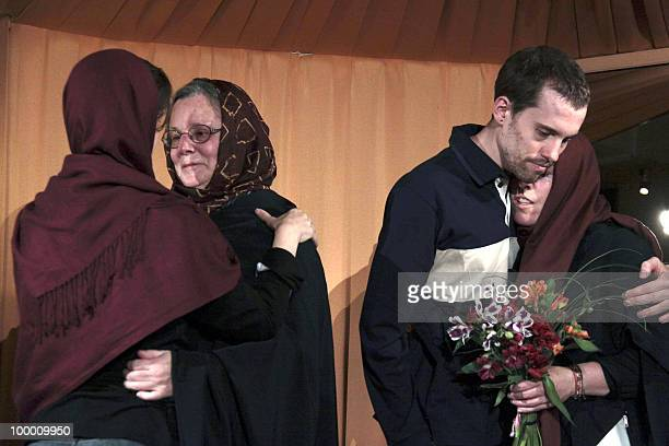 A picture obtained from Iran's staterun Englishlanguage Press TV shows detained US hikers Shane Bauer and Sarah Shourd hugging their mothers Cindy...