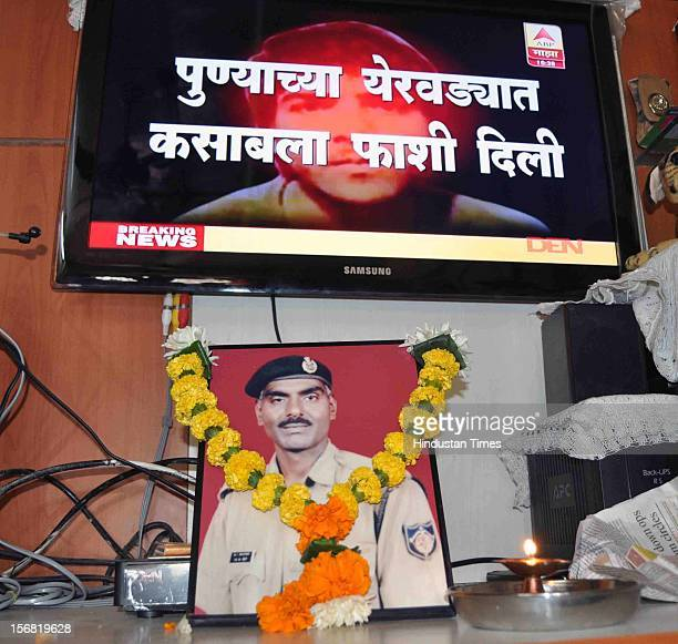 Picture of 26/11 Martyr Head Constable Murlidhar Choudhary as his family celebrate the news of Ajmal Kasab's hanging on November 21 2012 in Mumbai...