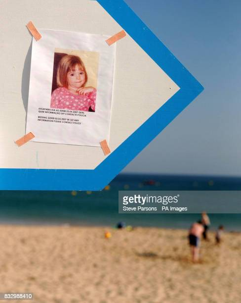 A picture of 3yearold Madeleine McCann who went missing on Thursday evening is displayed on a sign on a beach in Luz in the Algarve