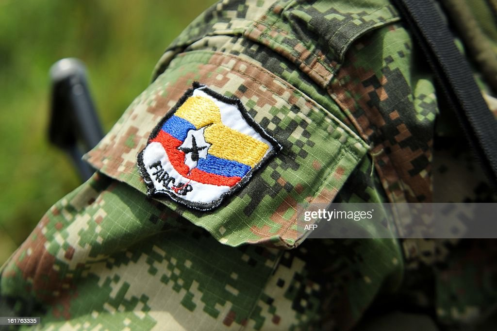Picture of a badge on the arm of member of the Revolutionary Armed Forces of Colombia (FARC) guerrillas, taken while he guards the mountainous region of the department of Cauca, around Montealagre, Colombia, on February 15, 2013 after they released Colombian police officers Victor Alfonso Gonzalez and Cristian Camilo Yate. Leftist Colombian guerrillas on Friday released two police officers they had held for three weeks, the International Committee of the Red Cross said. The men were released in a rural area in Cauca department in southwestern Colombia and were in good health, the ICRC said in a statement.