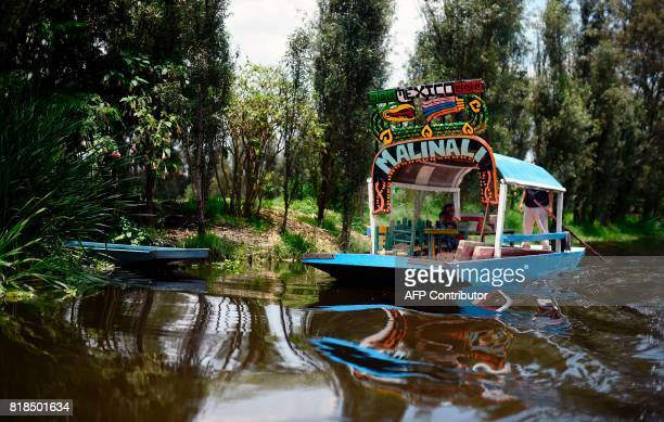 Picture of a boat known as 'Trajinera' taken in a water channel amid the floating gardens of Xochimilco a UNESCO World Heritage Site during a...