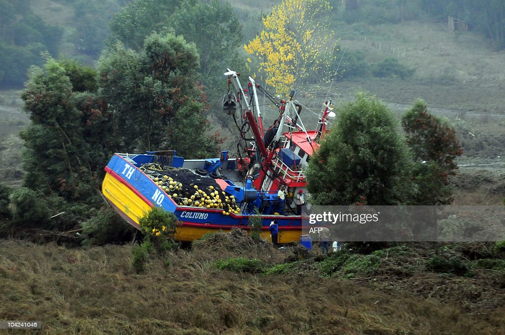 Picture of a boat left stranded in the middle of a hill after a tsunami in the Chilean city of Dichato some 30 km from Concepcion on March 1 three...