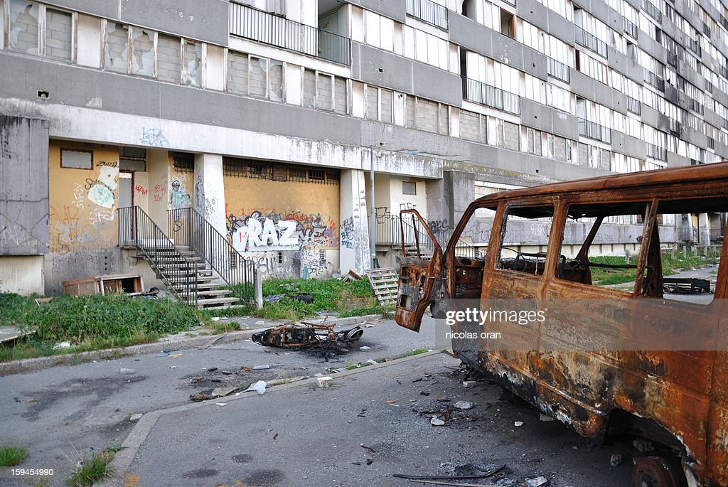 CONTENT] picture of a burned car taken in the ghetto of les bosquets in montfermeil paris's suburb.