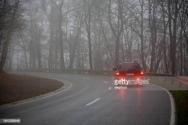 Picture of a car on the road on a gray day