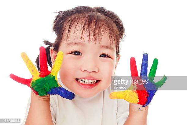 A picture of a child with paint on her hands