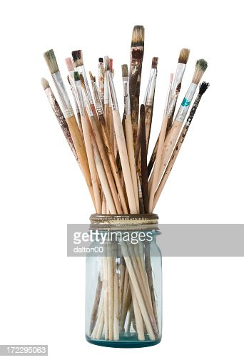 Picture of a clear jar filled with paint brushes