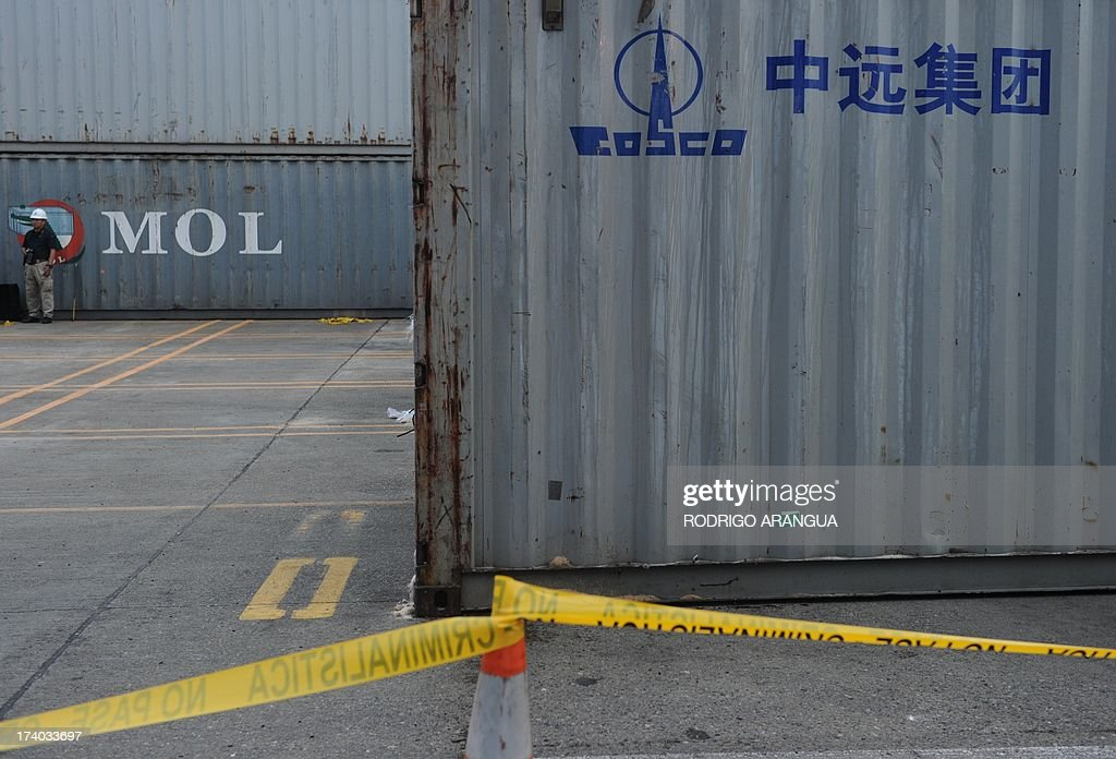 Picture of a container (R) of the North Korean Chong Chon Gang vessel in which an alleged ageing Soviet-built radar control system for surface-to-air missiles was found, taken at the Manzanillo Port in Colon, 90 km from Panama City, on July 19, 2013. UN sanctions experts will go to Panama soon to investigate a North Korean ship that was intercepted carrying weapons, a US diplomat said Thursday. The vessel set out from Cuba and was trying to enter the Panama Canal when it was stopped by an anti-narcotics patrol, which later found the weapons concealed beneath several tonnes of sugar. AFP PHOTO / Rodrigo ARANGUA