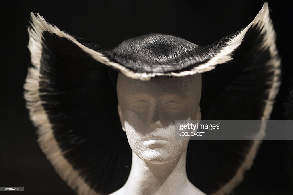 LACUT - Picture of a creation by Charlie Le Mindu, hairdresser and designer, taken before a 'Haute Coiffure' fashion show on January 21, 2013 in Paris. Charlie is a French designer that created an outfit and various hats and headpieces worn by Lady Gaga.