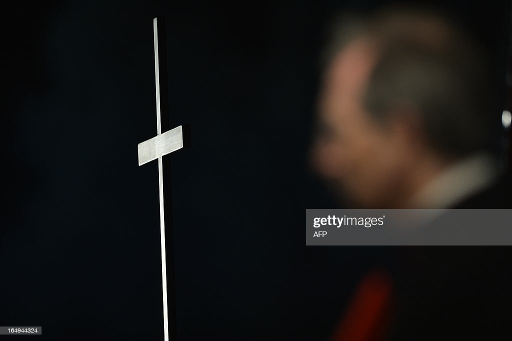 Picture of a cross taken during the celebration of the Way of the Cross on Good Friday on March 29, 2013 at the Colosseum in Rome. Pope Francis presided over his first Good Friday which will culminate in a torch-lit procession at Rome's Colosseum and prayers for peace in a Middle East 'torn apart by injustice and conflicts'.