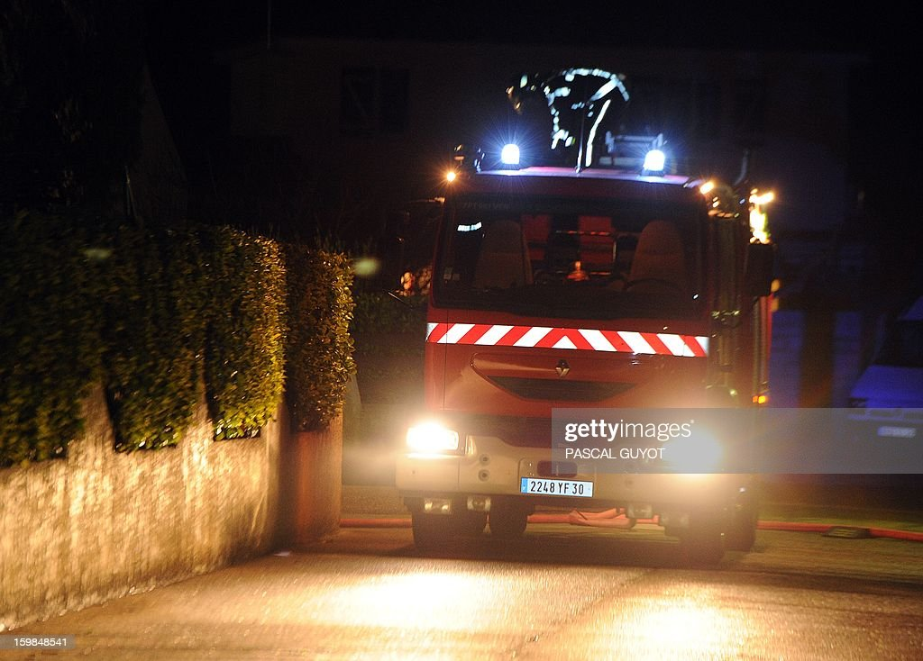 Picture of a firemen truck taken near a house where five people were found dead on January 21, 2013 in Garons, near Nimes, southern France. The bodies of two adults and three children were found by firemen after a neigbour called for a fire in the afternoon.