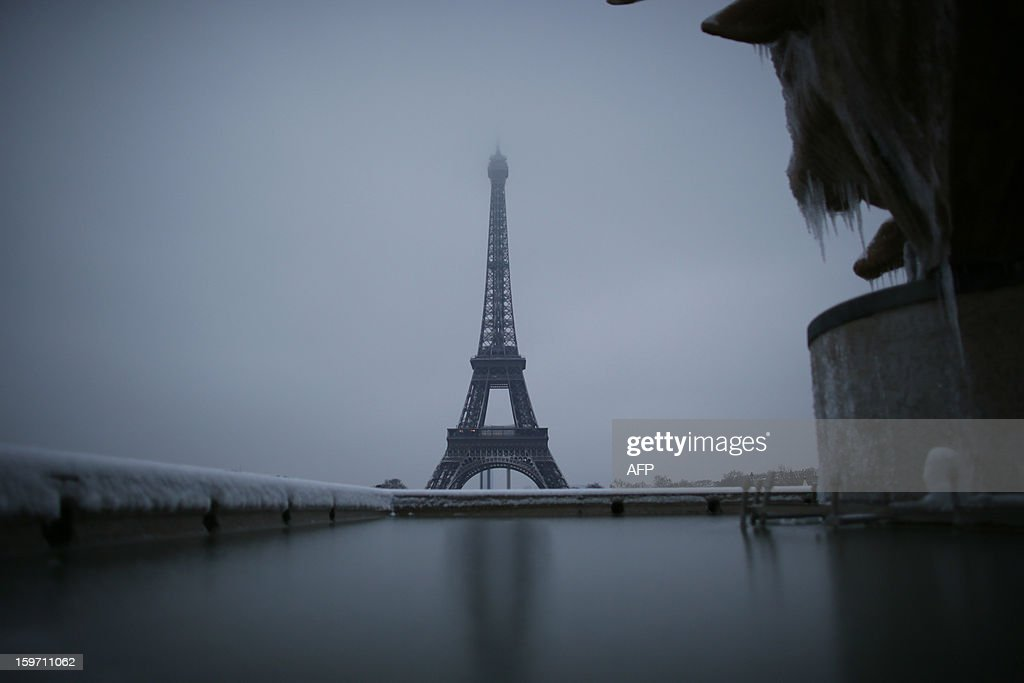 Picture of a frozen sculpture near the Eiffel tower taken on January 19, 2013 in Paris, after the snow fell over the French capital overnight.