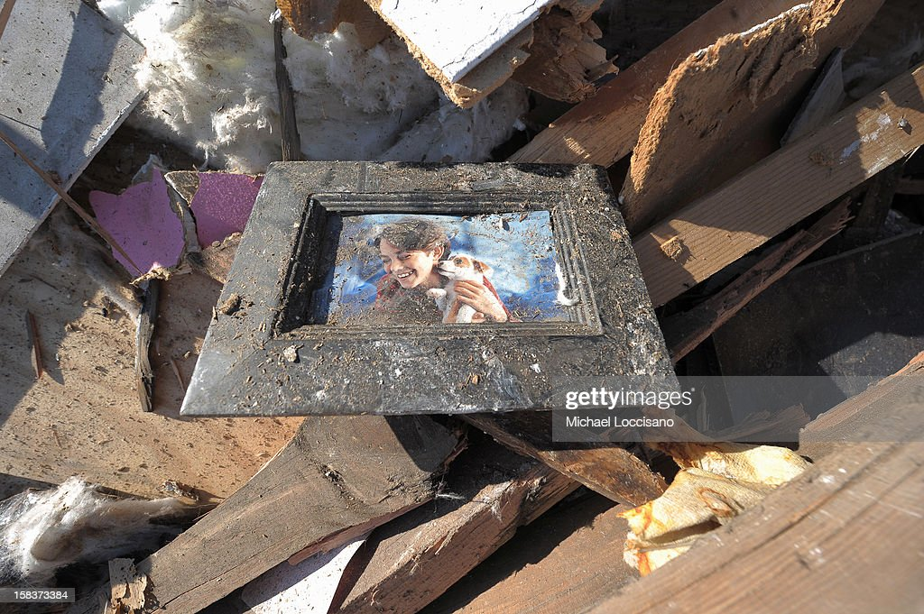 A picture of a girl and a dog lie in a pile of wreckage on December 14, 2012 in Union Beach, New Jersey. The town is struggling to rebuild and recover from the devastation left by Superstorm Sandy and relying heavily on donations.