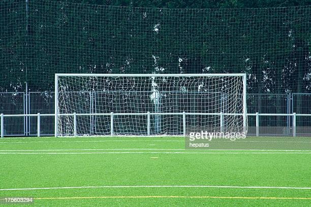 A picture of a goal in a field