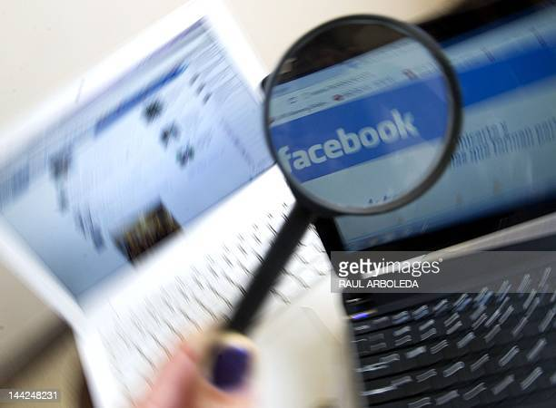 Picture of a magnifying glass on the homepage of Facebook website in Spanish language taken in Medellin Antioquia department Colombia on May 12 2012...